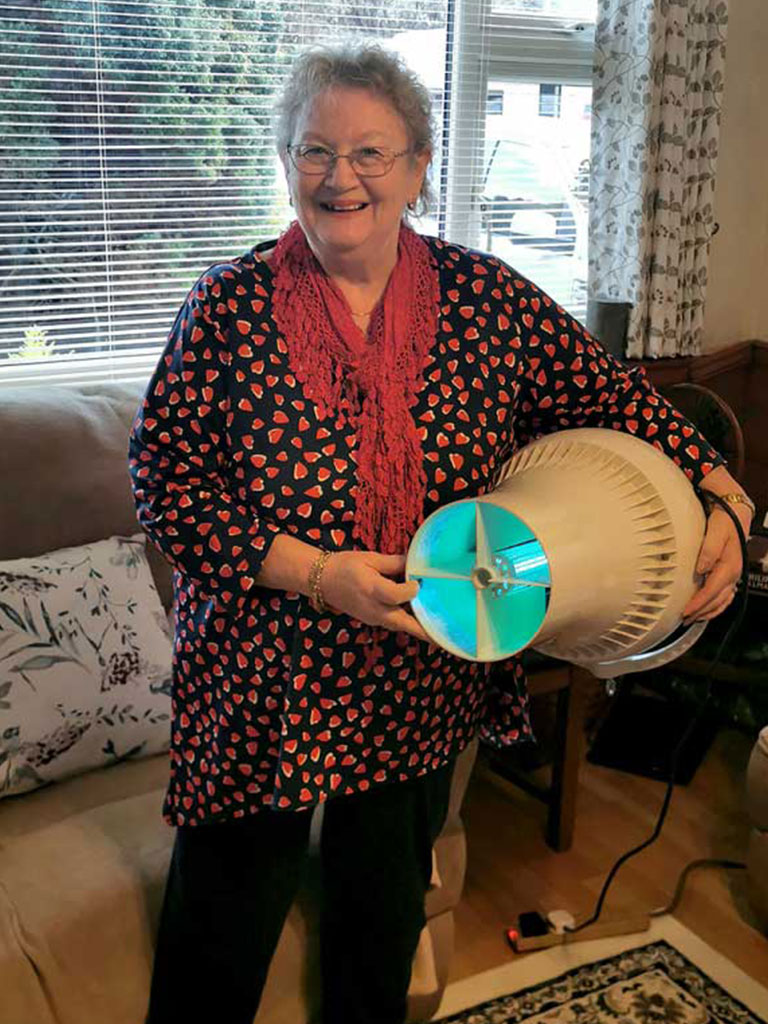 Anne Lord holding stood holding fan